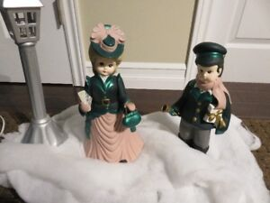 Ceramic Christmas Carolers décor  $20
