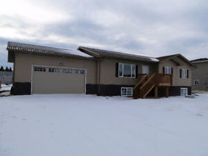 NEW Raised Bungalow, double garage, just 30 Mins West of Wpg