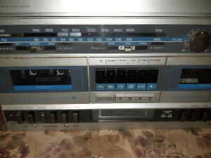 Sears record/8 track/ cassette player very good condition.