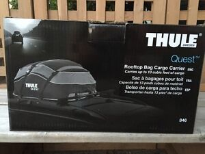 Brand new unopened rooftop THULE Cargo Carrier, 13 qft, $ 65 obo