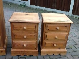 A PAIR OF SOLID BARE PINE BEDSIDE CUPBOARDS IN NEED OF TLC