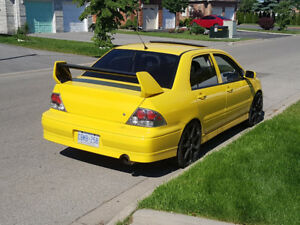 02-03 Lancer, Black Ralliart style Tail Lights.