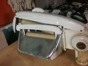 Tête de machine à laver ou tordeur