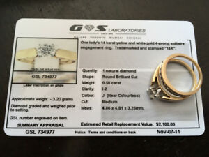 14 karat yellow and white gold 4 prong solitaire engagement ring