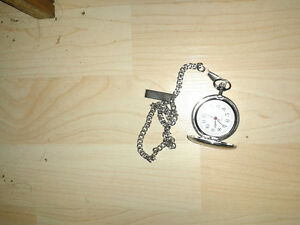 35 year old quartz pocket watch w/gold rim & silver chain & clip