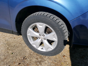 225/60 R17 almost new snow tires from Subaru Forester