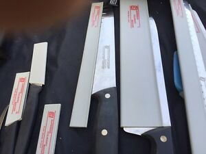 9 Professional knifes with sharpening rode for sale. $400 o.b.o