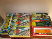 7 Vintage Train Cars in Original Boxes plus book