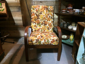Vintage wood and floral cushioned chair
