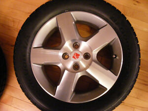 Four Saturn Ion 3 Mag Wheels with Tires 225/50R16