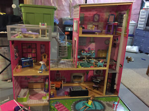 KidKraft dollhouse, stocked with furniture + bonus Barbie corvet