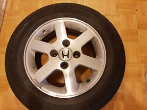 4 Michelin X-radial summer tires P195/65 R15 on Honda rims