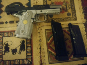 W.E baby capa 38 with extended mag .
