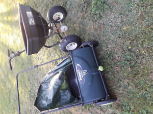 Seed spreader and lawn sweeper