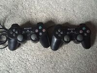 2 X untested PlayStation 2 controllers.