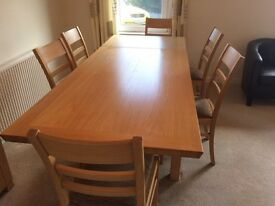 Light oak table with six chairs.