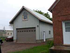 House for sale with service garage and winter storage garage