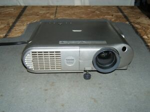 Toshiba projector with motorized projector screen.