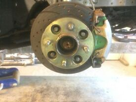 Ford puma front brake callipers , with green stuff pads and dotted and grooved discs