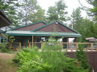 **** CUSTOM-BUILT 4 SEASON COTTAGE ON 4 MILE LAKE ****