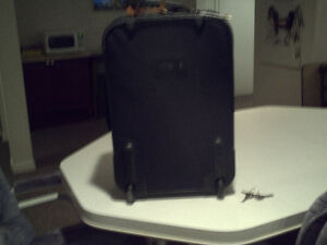 American Tourister Chrck-in Luggage