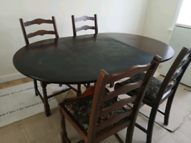 Hard wood extendable dining table with 4 chairs