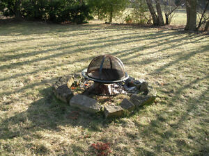 Outdoor fireplace with stone