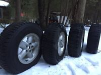 Jeep rims w/ 225/75r15 Goodyear Nordic tires