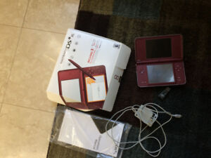 Red DSi XL with tens of games