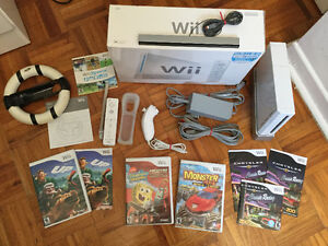 Wii blanche complete-manette-nunshock+ jeux+ Volant - 100$