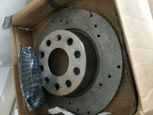 BRAND NEW UPGRADED VW PASSAT BRAKE PADS AND ROTORS (REAR)