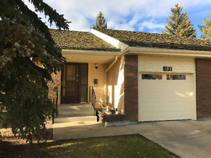 Adult Bungalow with attached garage for under $300K