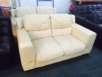 2 large cream leather 2 seater sofas