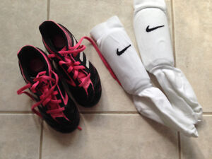 Size 12 girl soccer cleats and shin pads