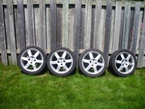 Nissan 17 inch tires and mags for sale