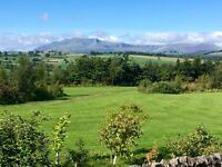 Luxury Log Cabin with unobstructed view of Blencathra and the hills of the northern Lake District