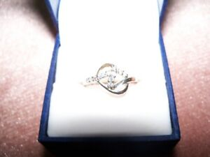 Gold / Zirconia Love Knot Ring for sale. Size 5, Good Cond, etc.