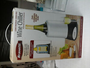 Continous wine chiller  plug in like new in box
