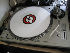 PAIR of technic MK5 silver turntables. Like new. With road cases