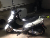 White Scooter - hardly used (with helmet)