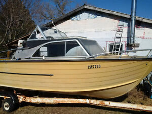 Aluminum boat and trailer for sale or scrap.