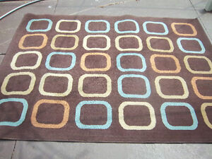 "Indoor Area Rug 63"" x 88"" In Decent Condition"