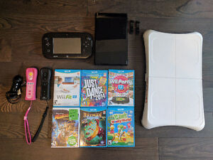 Wii U Console with remotes and Wii fit u and 10 games