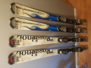 Two sets of downhill skis for sale with ski boots