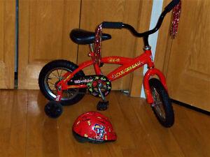Vélo 12 pouces Louis garneau rouge Bicyclette impeccable
