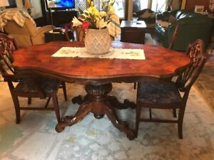 Antique dining room table with six chairs.