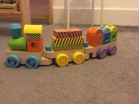 Wood stacking train toy