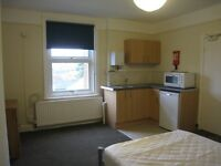 Top floor furnished bedsit close to city