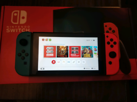 Nintendo switch console with games and memory card