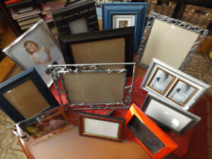 Pictures frames, two vase with flowers also 3 decorative stars